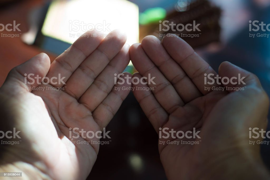 Muslims pray at a mosque groom during the wedding ceremony. stock photo