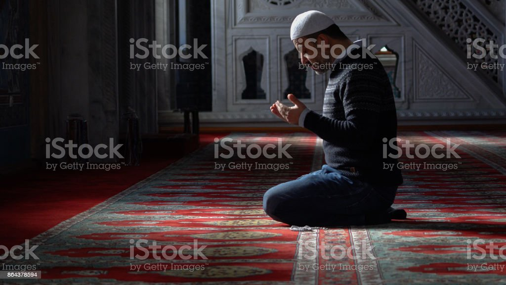 Muslims prayer in mosque stock photo