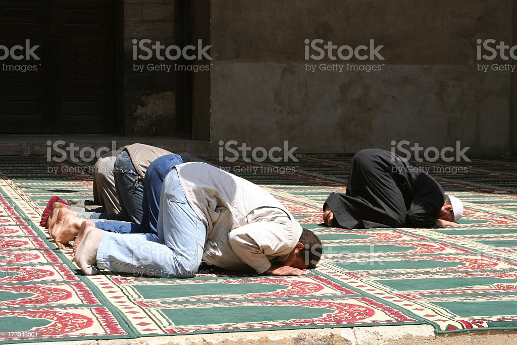 Muslims Praying in a mosque in Cairo, Egypt. stock photo