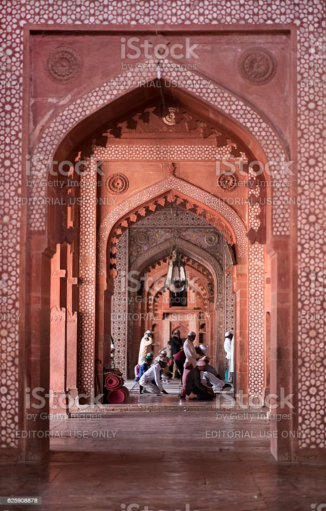 Muslims praying inside Jama Masjid Friday Mosque stock photo