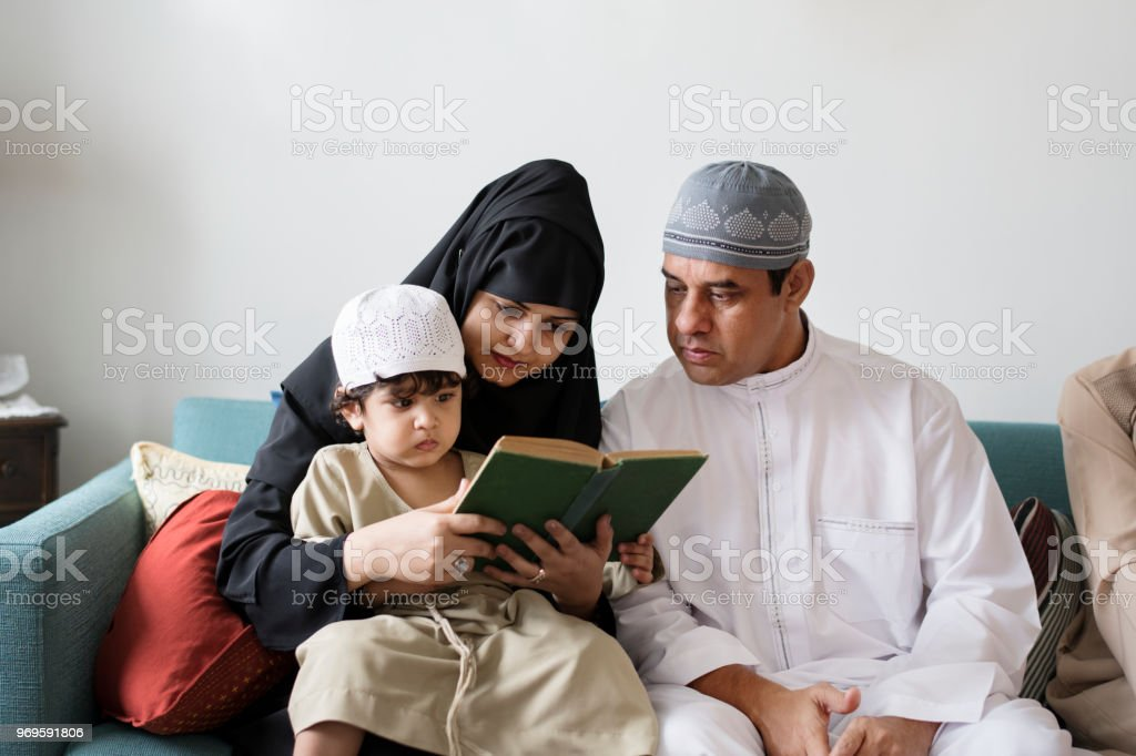 Muslims reading from the quran stock photo