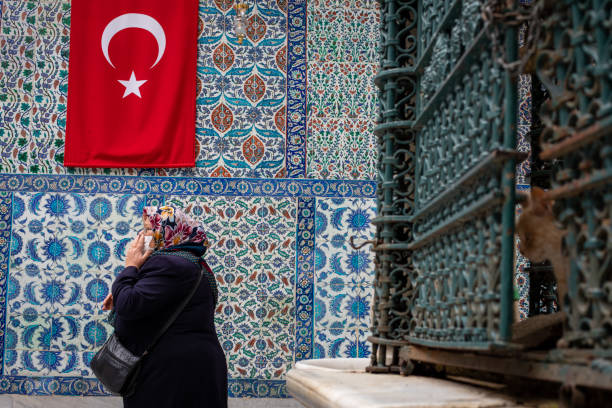 Muslims who pray in the courtyard of the Eyup Sultan Mosque, one of the symbols of Istanbul. stock photo