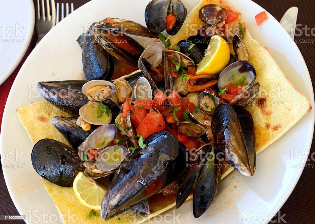 Zuppa di Cozze e Arselle (Shellfish Soup) stock photo