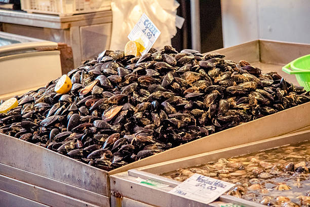 mussels and lemon in Catania market, Sicily stock photo