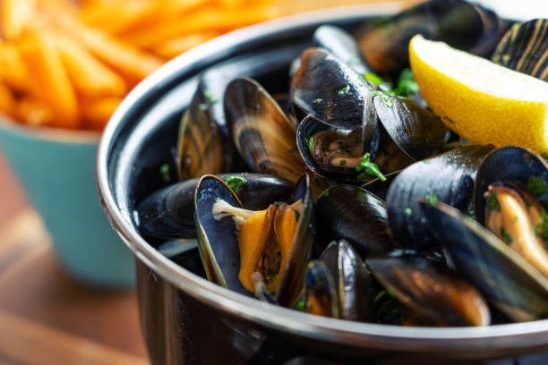 Mussels and sweet potato fries healthy food for lunch dinner mussel stock pictures, royalty-free photos & images