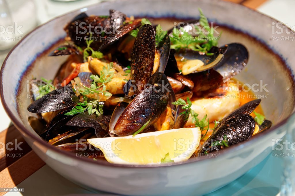 Mussels in a deep clay bowl stock photo
