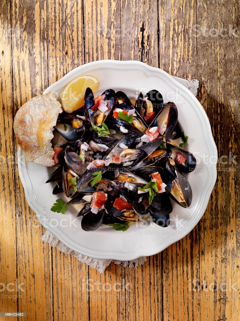 Mussels in Cream Sauce with Tomatoes and Garlic stock photo