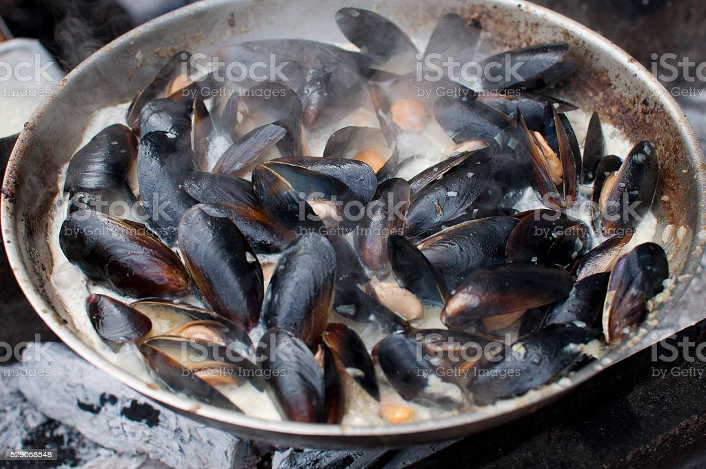 Mussels in frying pan stock photo