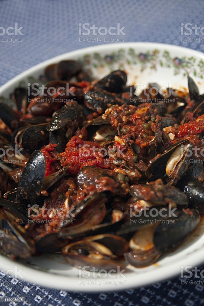 Mussels in red sauce stock photo