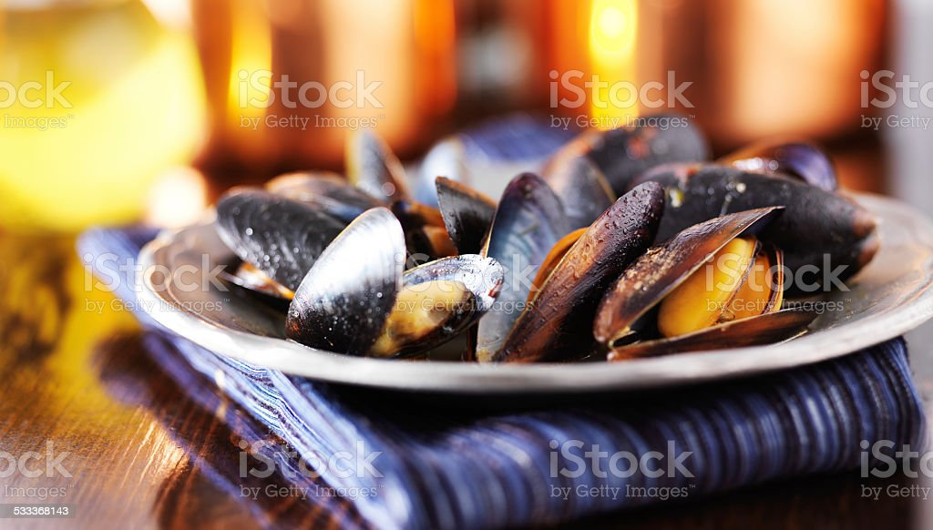 mussels in white wine garlic sauce stock photo