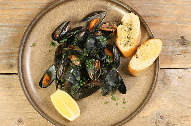 mussels with lemon and garlic bread stock photo