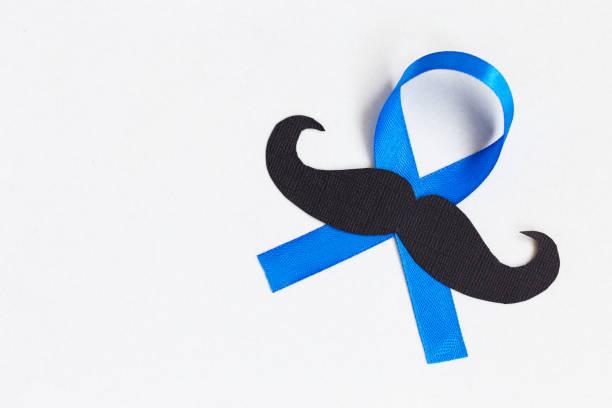 Schnurrbart-Muster mit blauen Band-Symbol. Movember Konzept. – Foto