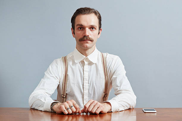 Mustached Handsome Man Posing Mustached handsome man posing in front of wall mustache stock pictures, royalty-free photos & images