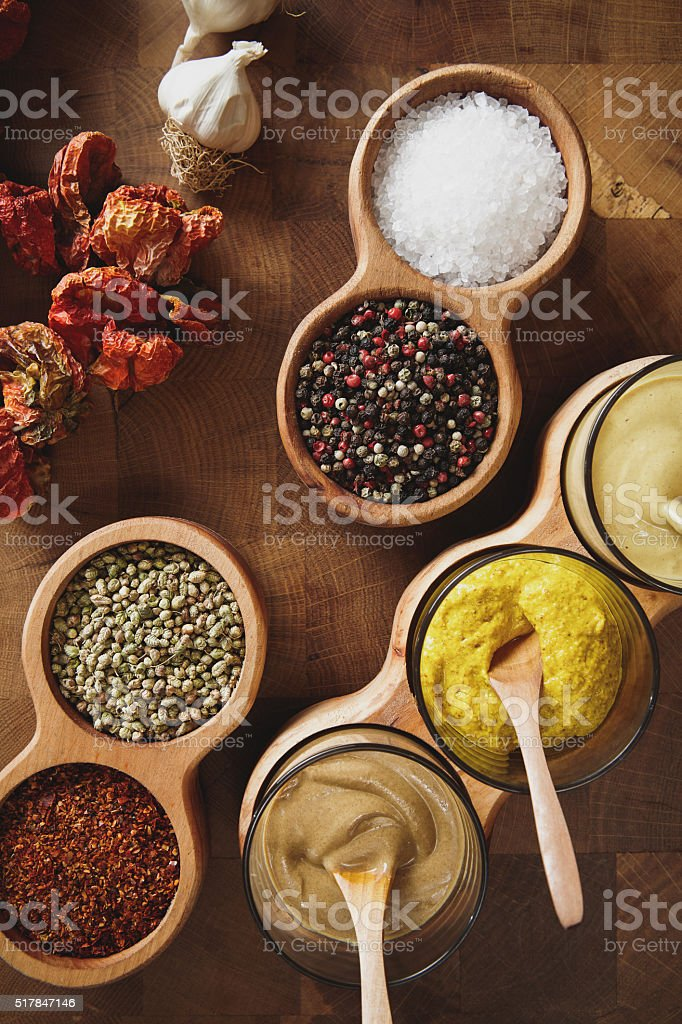 Mustard and spice varieties in bowls stock photo