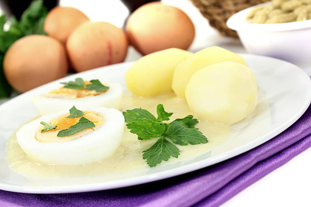 Mustard eggs with potatoes and smooth parsley stock photo
