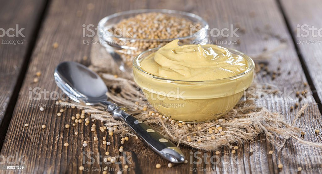 Mustard in a small bowl stock photo