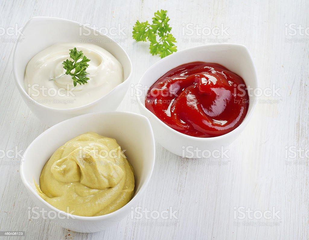 Mustard, ketchup and mayonnaise stock photo