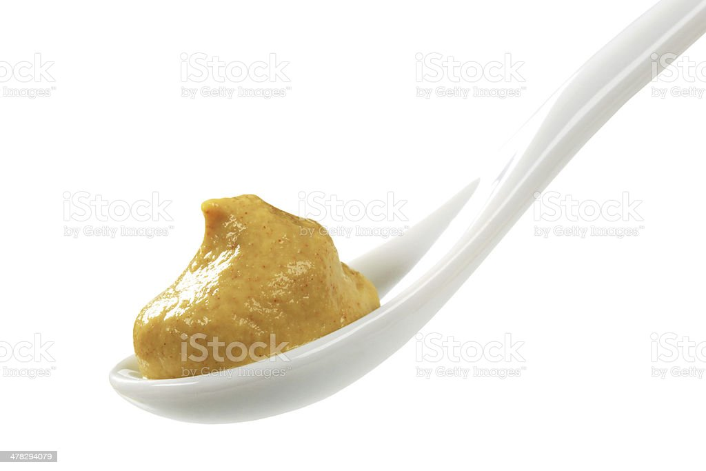 mustard on a spoon royalty-free stock photo