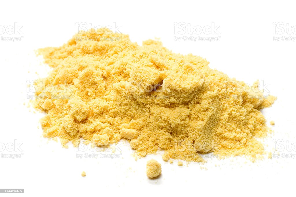 Mustard powder on a white background stock photo