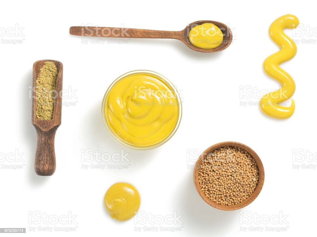 mustard sauce in bowl isolated on white stock photo