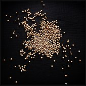 Black background and mustard seeds.  iPhone