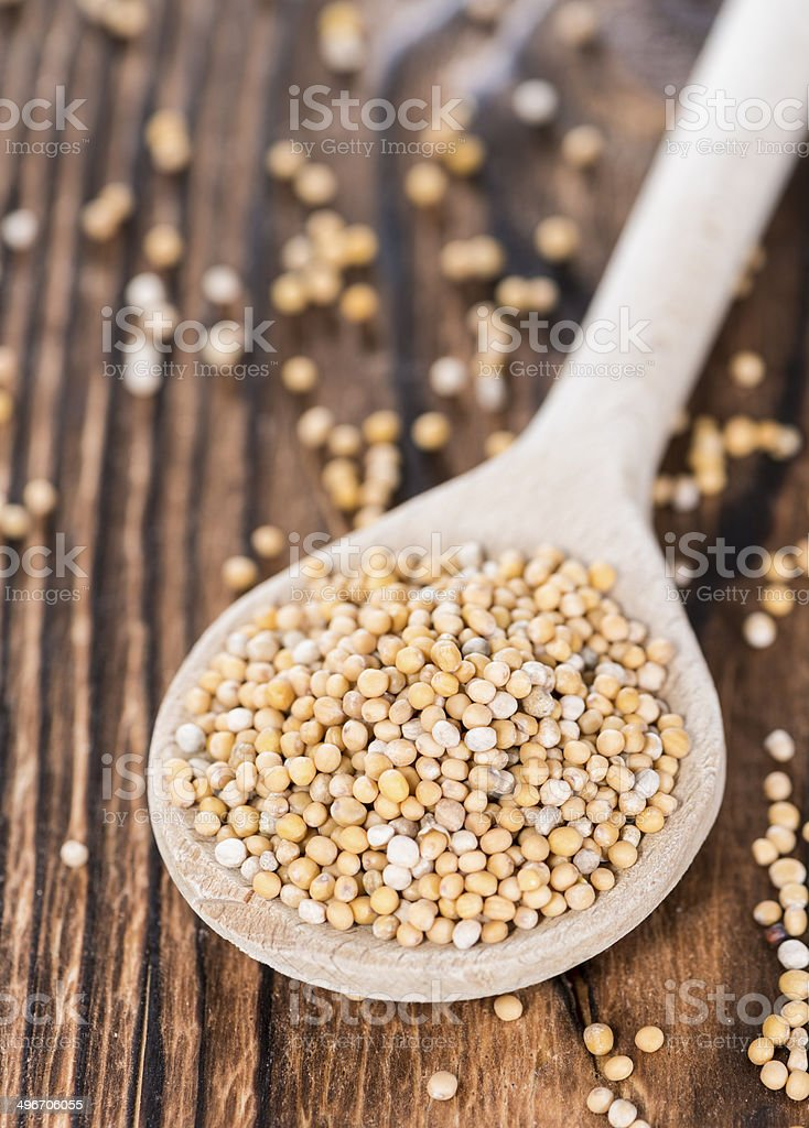 Mustard Seeds on a cooking Spoon stock photo