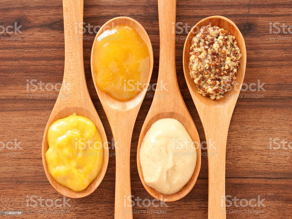 Mustard varieties in spoons stock photo
