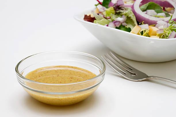 Mustard Vinaigrette Salad Dressing Mustard vinaigrette salad dressing in small glass bowl vinaigrette dressing stock pictures, royalty-free photos & images