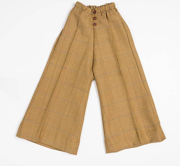 Mustard Wide-Leg Children's Pants on white background stock photo