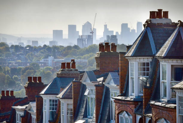 Muswell Hill The London suburb of Muswell Hill. Rooftops of Victorian homes and street with view across London to the offices and workplaces of Canary Wharf uk stock pictures, royalty-free photos & images