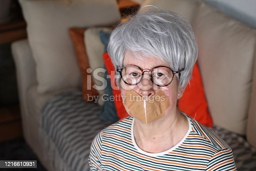 istock Muted senior woman at home 1216610931