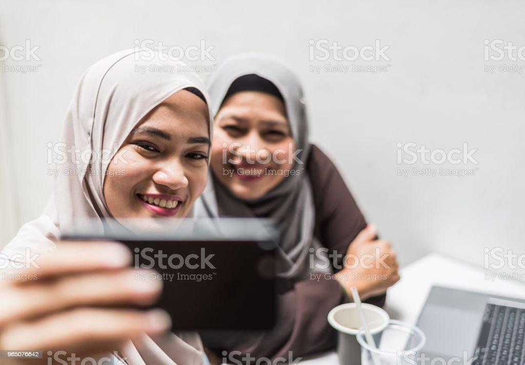 Mutilcultural women taking selfie after work zbiór zdjęć royalty-free