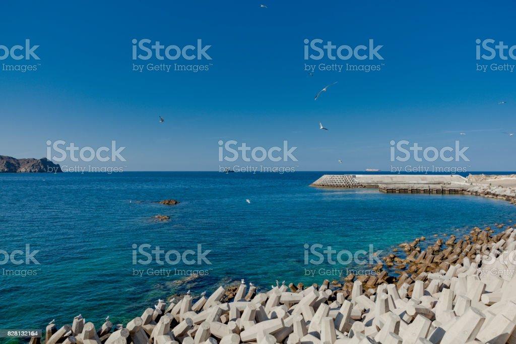 mutrah corniche coastline wavebreakers, muscat, oman. stock photo