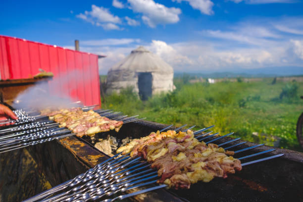 Mutton kebab Prepare mutton kebab in grassland in Xinjiang, China. mongolian culture stock pictures, royalty-free photos & images