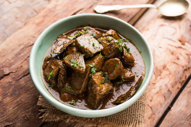 Mutton Liver fry or Kaleji masala, popular Non vegetarian recipe from India and Pakistan. served dry or with curry in a bowl, karahi or plate Mutton Liver fry or Kaleji masala, popular Non vegetarian recipe from India and Pakistan. served dry or with curry in a bowl, karahi or plate beef stew stock pictures, royalty-free photos & images