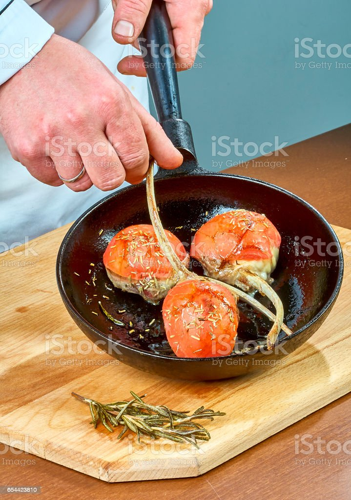 Mutton ribs fried in a frying pan full collection of culinary recipes stock photo