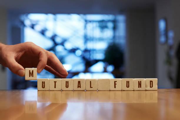 Gegenseitige Fonds Konzept mit Alphabet Blöcke – Foto
