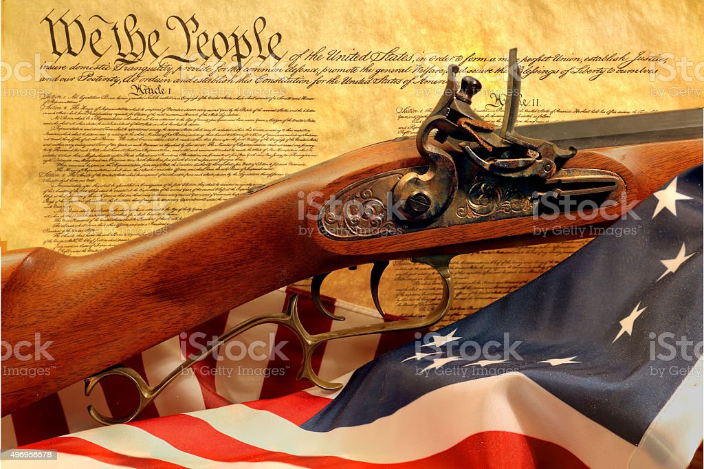 muzzleloader rifle with constitution and flag stock photo