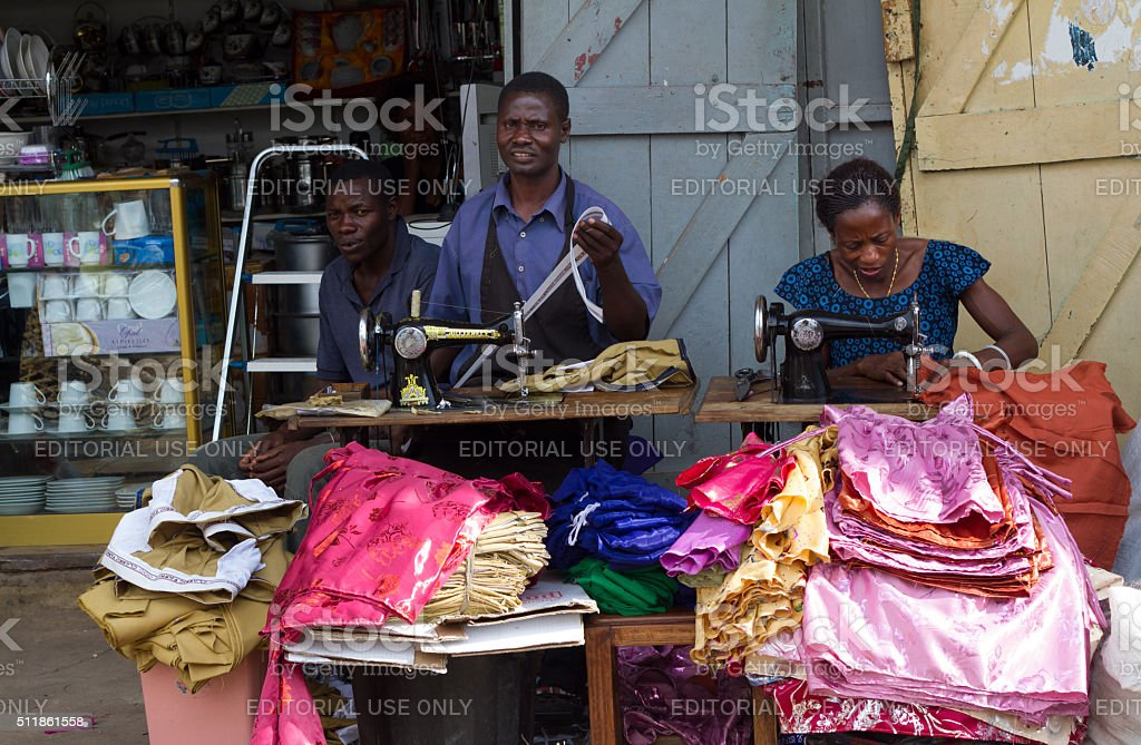 Mwanza, Tanzania: Garment Workers Sewing on the Sidewalk stock photo