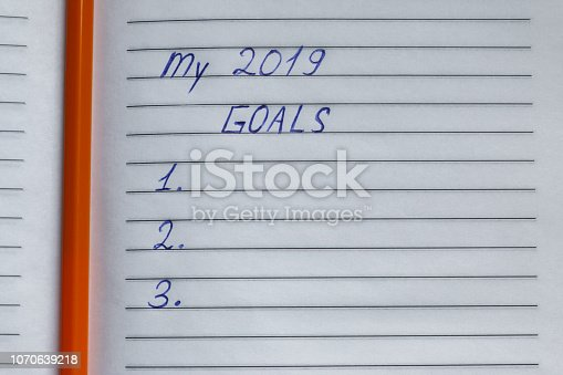 1186985932 istock photo My 2019 goals - handwritten inscription written in blue ink on white striped paper 1070639218