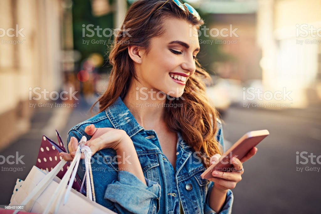 My app makes shopping even more fun by offering discounts royalty-free stock photo