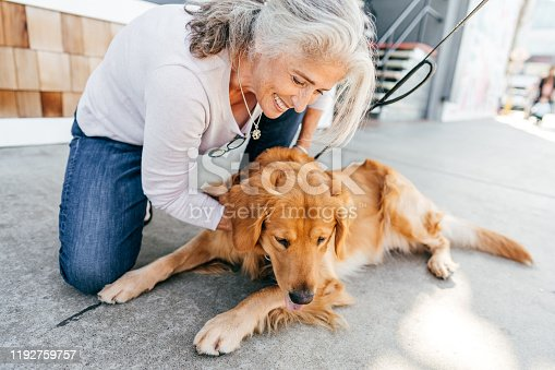 Smiling senior woman with her dog