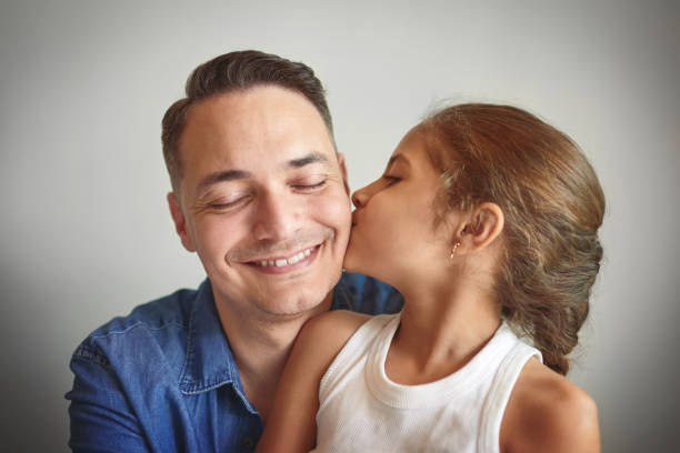 My dad is my hero! Shot of a man spending quality time with his young daughter little girl kissing dad on cheek stock pictures, royalty-free photos & images