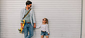 Portrait of a young father and his cool little daughter // wide photo dimensions
