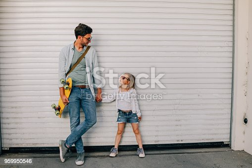Portrait of a young father and his cool little daughter