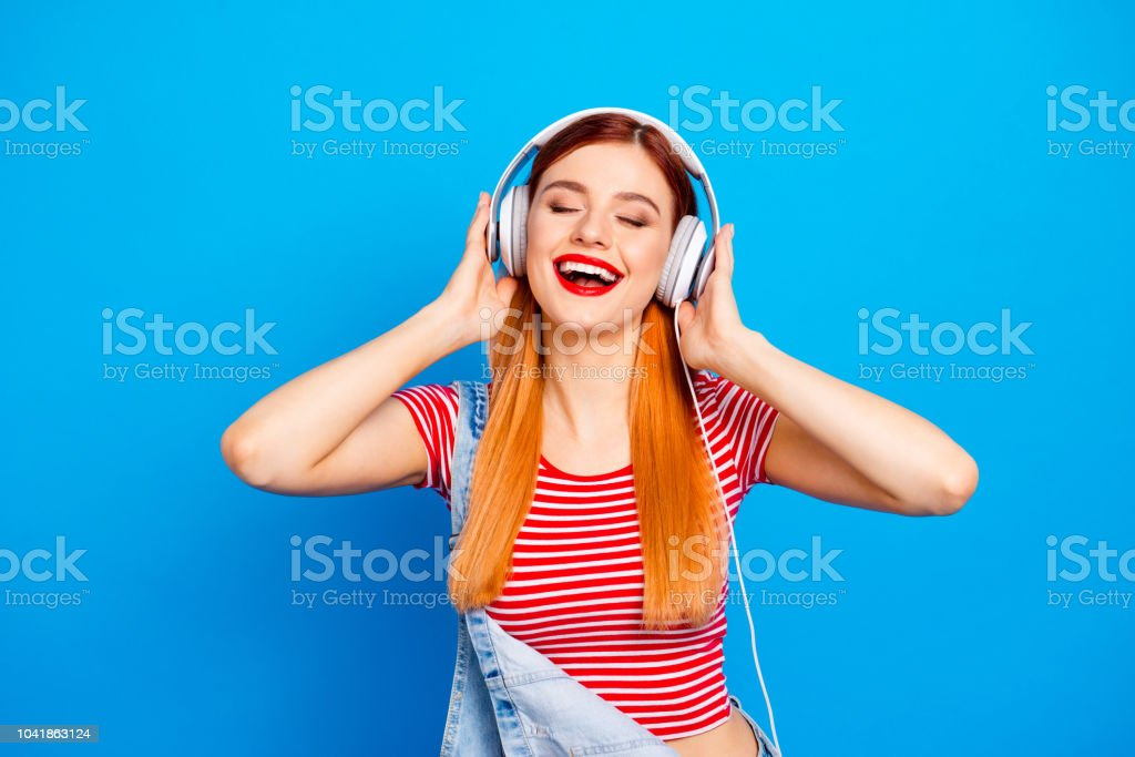 My favorite track! Close up photo portrait of positive optimistic with beaming toothy smile long hairstyle wearing white headset girl isolated bright vivid background stock photo