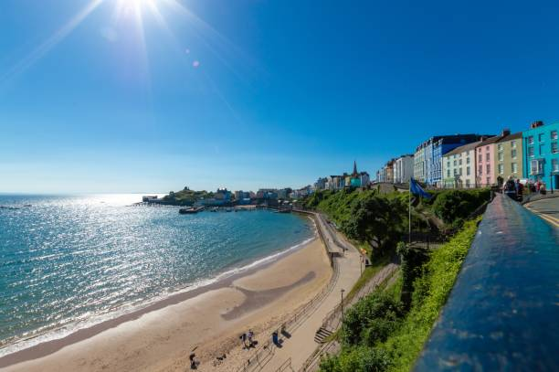 My favourite beach, north beach in Tenby North beach in Tenby in the early morning at high tide wales stock pictures, royalty-free photos & images