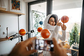 Children playing with space rocket in apartment with his dad