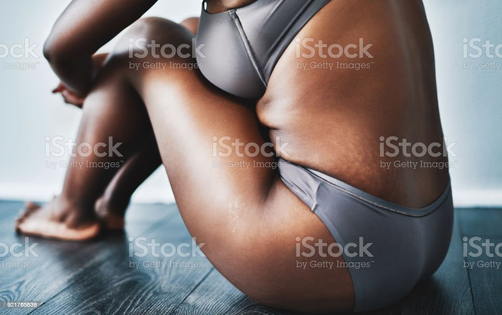 My flaws is what makes me beautiful Studio shot of an unrecognizable woman posing against a grey background Abstract Stock Photo