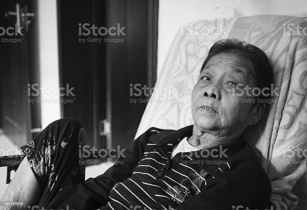 My grandmother resting on the couch royalty-free stock photo